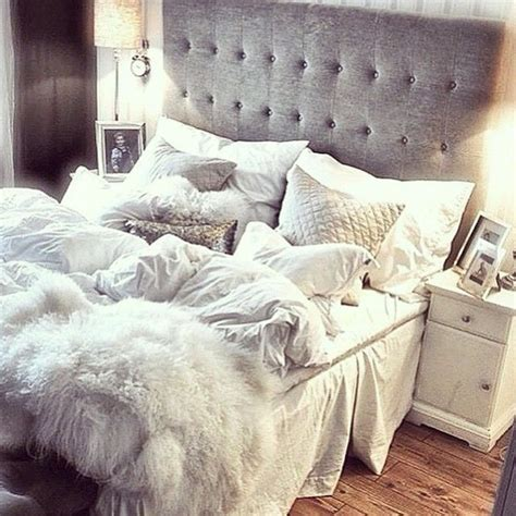 i love this tufted bed with white bedding and white