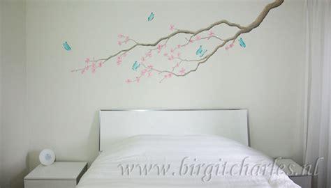 muurtekeningen woonkamer bloesem muurschildering voor een romantische kamer
