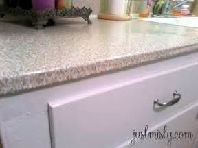 Self Stick Kitchen Backsplash using contact paper to cover and redo countertops