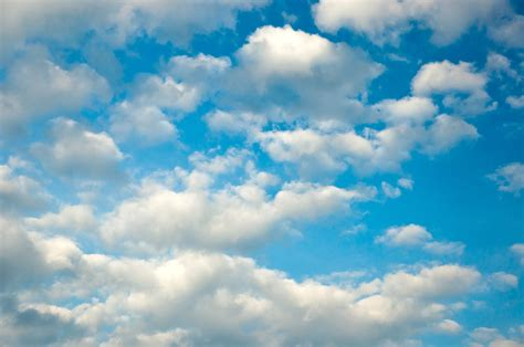 Fluffy clouds on a blue evening sky   Flickr   Photo Sharing!