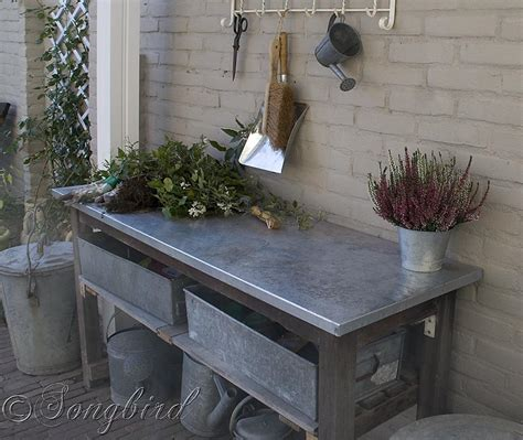galvanized potting bench vintage coat rack finishes a garden work area with a work bench with galvanized top bench