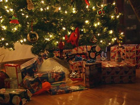 christmas presents under christmas tree don t be too