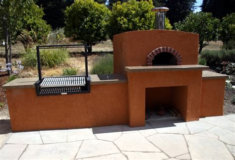 another outdoor kitchen with our wood fired oven no gas here charcoal bbq and wood fired pizza oven built
