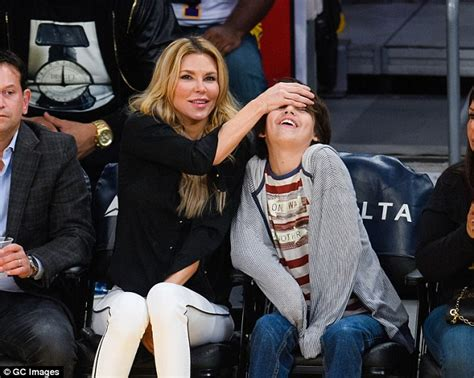real housewives brandi glanville openly shows disdain for ex suspense the star playfully covered her smiling son s eyes