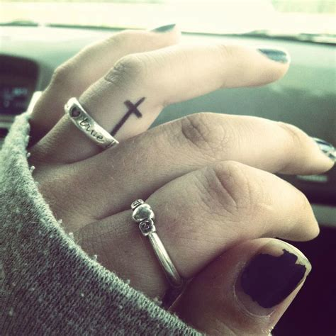 cross tattoo on finger meaning 60 best finger tattoos meanings ideas and designs for 2016