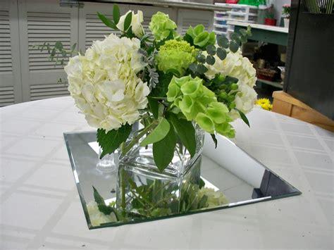 cubed vase arrangement with hydrangea and bells of ireland