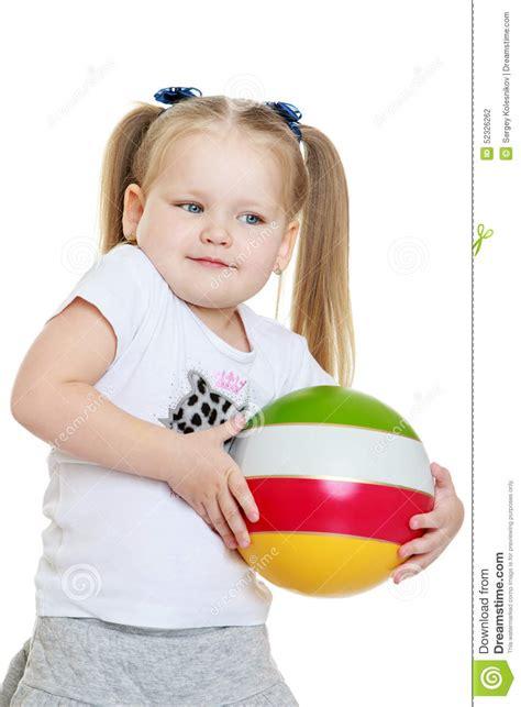 tiny chubby girls beautiful chubby little girl holding a ball stock photo
