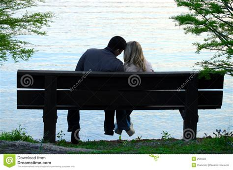 couple on park bench couple on a bench stock photos image 205633