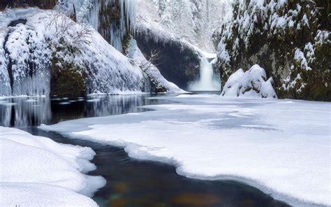 frozen river wallpaper waterfall on frozen river in the rocky mountains wallpaper