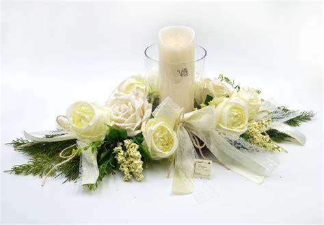 composizioni con candele centro tavola con porta candele in vetro e candela a led