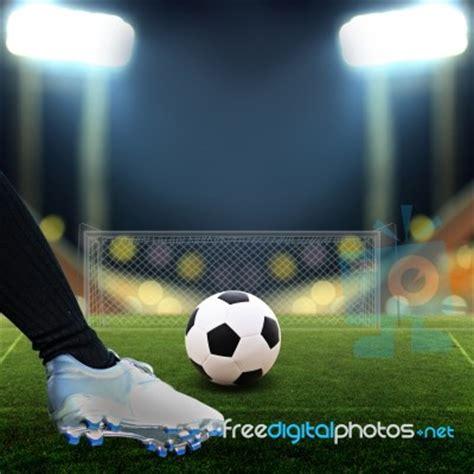 Soccer Kicking Net soccer player kicking soccer stock photo royalty