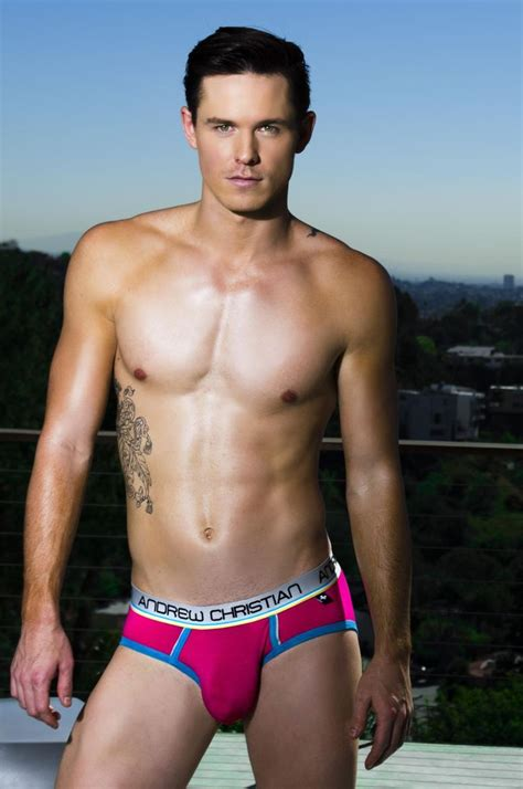 Young Speedo Model | young lean shirtless male model wearing a bubble gum pink