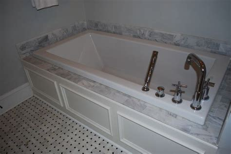 custom built bathtubs soaking tubs carrara marble and marble tiles on pinterest