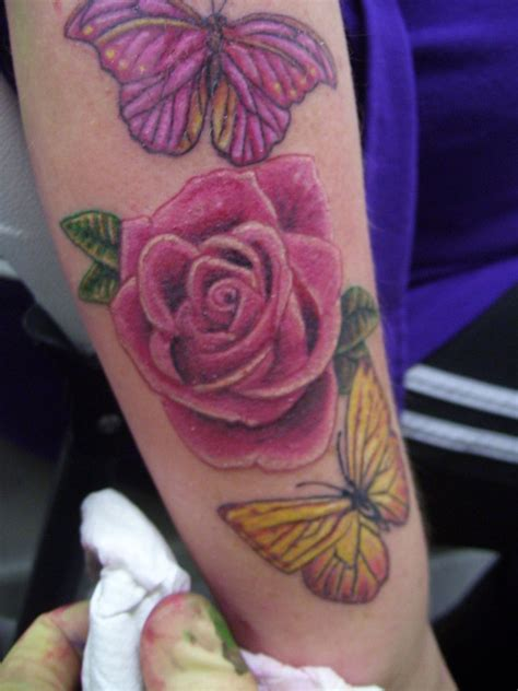 rose tattoo with butterfly and butterfly by lianjmc on deviantart