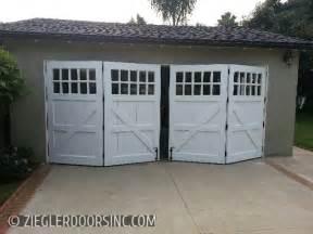 carriage garage door in a bi fold configuration east side