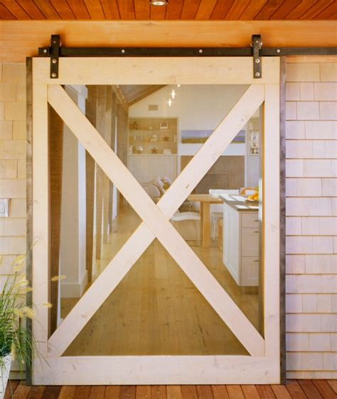This Glass Barn Door Lets In Light And Is A New Look For A Light Barn Doors