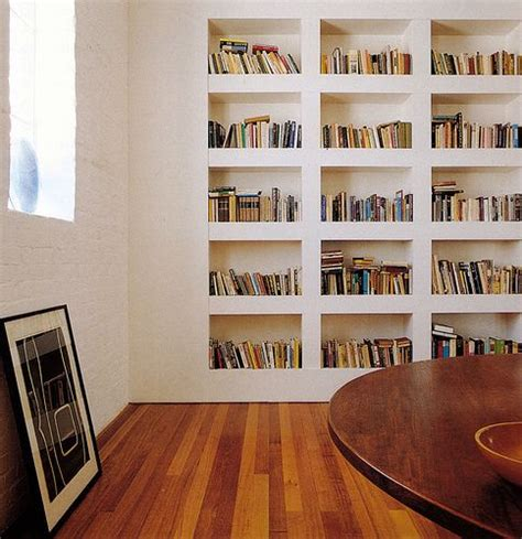 clean lined recessed built in bookcase almost looks like