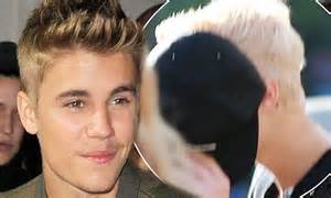 justin bieber tries to hide his newly bleached platinum