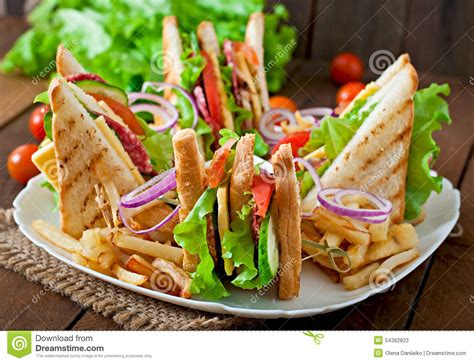 Buku Club Sandwich Pelengkap Chicken Soup For The Christian Soul tomato cheese and salad sandwich from fresh baguette on white ceramic plate on wooden