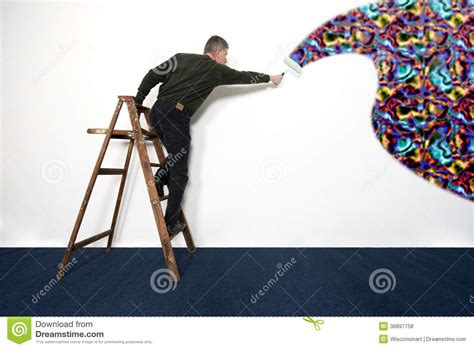paint man man painting white wall with wild colors royalty free