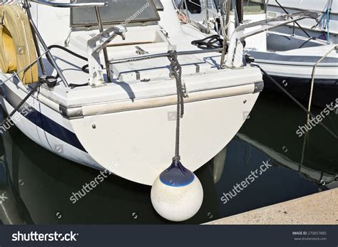 sailboat stern tie stern of a sailboat and marine bouy floating ball stock