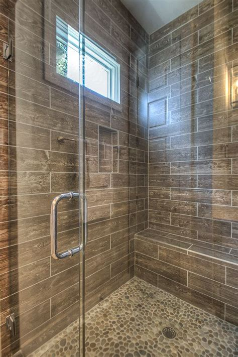 bathroom wood floor tile walls faux wood plank shower wall tile and pebble shower floor