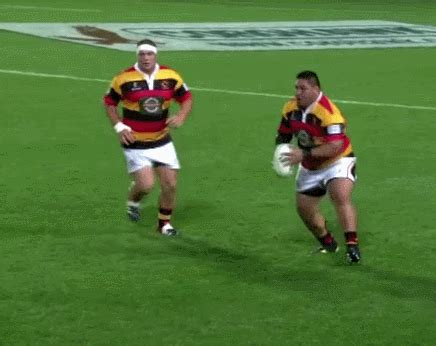 Ben Moore by Giant Rugby Player Tosses Aside Would Be Tackler With An