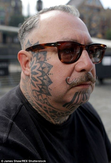 tattoo face with printer ink tattoo devotees showcase beautiful designs at east london