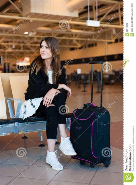 Waiting Intl waiting in international airport stock photo