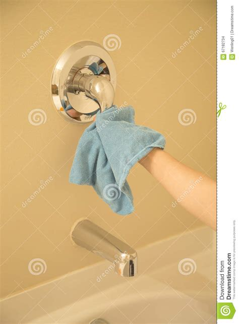 how to clean taps in the bathroom cleaning tap in the bathroom stock photo image 67182734