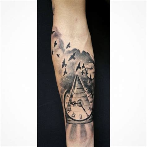 black ink pyramid with clock tattoo design for forearm by