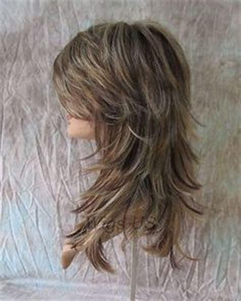 long shaggy hair for women front and back image long layered haircuts back view medium length layered