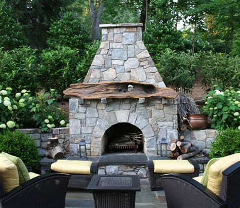 Outdoor Fieldstone Fireplace by Driftwood Mantel On Fieldstone Outdoor Fireplace