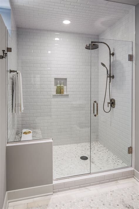 subway tile shower the guest bath had a shower area that was dated and confining a new frameless glass shower is