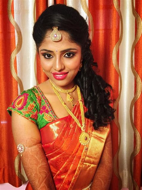 hairstyle design for reception traditional southern indian bride wearing bridal silk