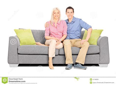 sofa sitting young couple sitting on a modern sofa stock photo image
