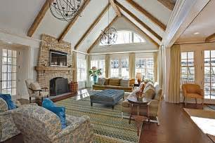 traditional great room with wainscoting high ceiling