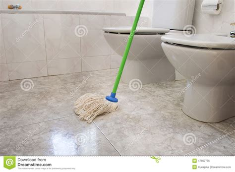 Mopping Bathroom Floor by Scrubbing Bathroom With A Mop Gray Stock Photo Image