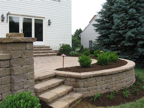 elevated patio design with planter deck patio