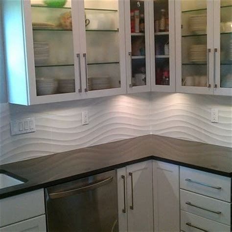 white linear wave tile kitchen backsplash and shower