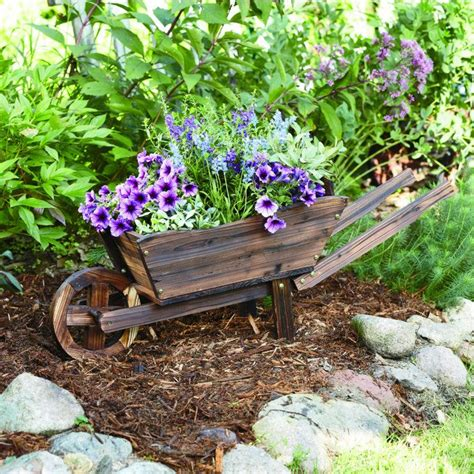 Rustic Wheelbarrow Planter by Made With Durable Cedar Wood With A Rustic Antiqued Finish