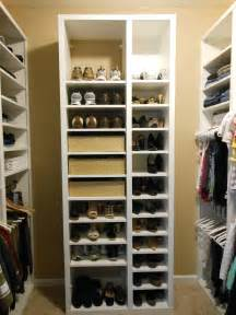 brown hardwood built in cabinetry as clothes and shoe organizer closet design with drawers and