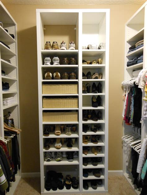 brown hardwood built in cabinetry as clothes and shoe
