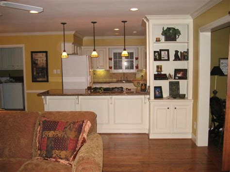 separation between kitchen and living room fireplace mantel shelves