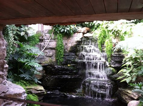 pond designs with small waterfall and indoor