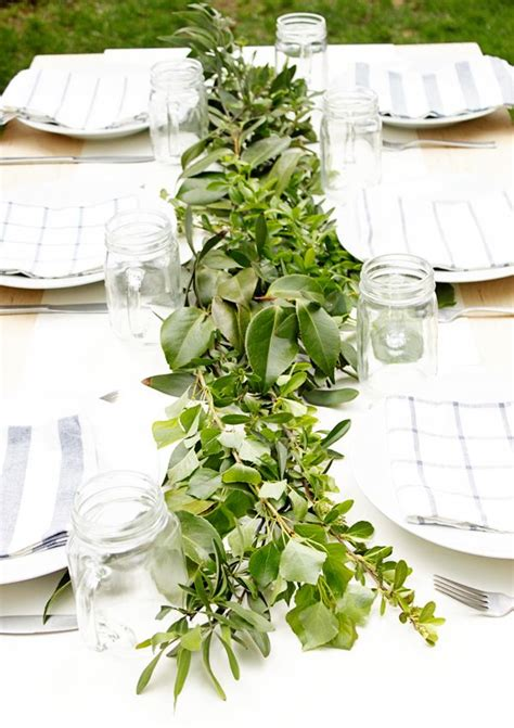 greenery on the spring table spring fling centerpieces
