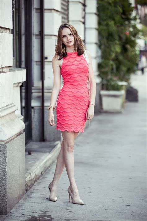 light pink dress with black heels is heel