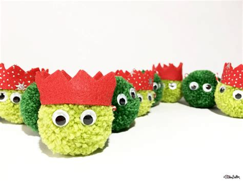 christmas sprout pom pom garland by eliston button close