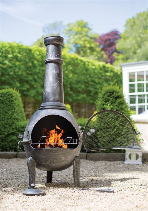 large steel chimenea in pewter effect with bbq grill
