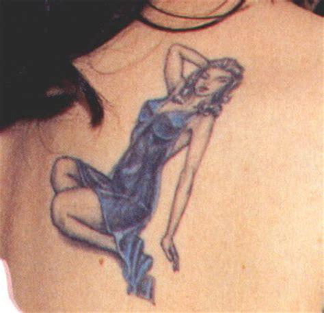 rose mcgowan tattoo list inkedceleb